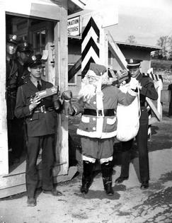 Santa is detained at the Elza Gate in Oak Ridge Tn in this famous 1944 photo taken by famed manahattan project photographer  Ed Westcott.